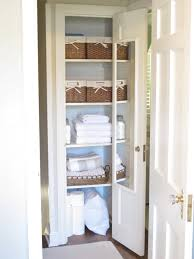 nrown stained wooden linen cabinet storage combined with white