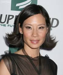 lucy liu with her short hair flipping out on the sides