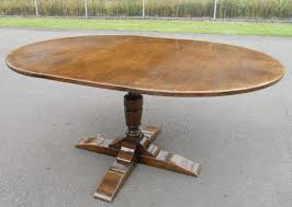 round oak pedestal extending dining table to seat eight