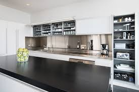 white kitchen cabinets with stainless steel backsplash stainless steel kitchen backsplash modern kitchen