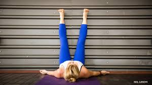 The Chair Is Against The Wall Legs Up The Wall Pose Viparita Karani Yoga Journal