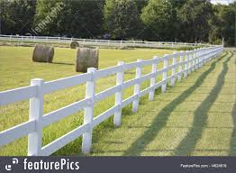 white fence and rolls of hay stock picture i4624619 at featurepics