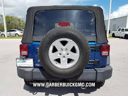 jeep wrangler dark grey pre owned 2010 jeep wrangler for sale in ft pierce fl at garber