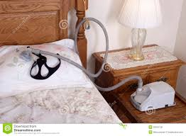 Cpap Nightstand Cpap Sleep Apnea Machine Lying On Bed In Bedroom Stock Photo