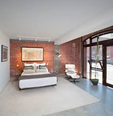 brick wall bedroom transitional with night stand traditional track