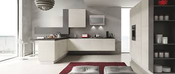 linear kitchen with minimalist design and wood finishes