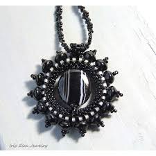 black beaded pendant necklace images Black agate sunburst pendant necklace iris elm jewelry unique jpg