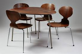 dining table and four chairs designed by arne jacobsen for fritz