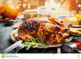 plate of thanksgiving food thanksgiving day dinner table setting with whole roasted turkey or