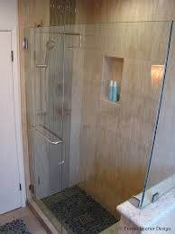 fiorito interior design an island bathroom by fiorito interior design the shower floor is lined with pebbles from island stone the same material is featured in a