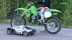 motocross bikes videos kawasaki dirt bike challenges an rc car in this unconventional off