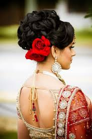 akshara wedding hairstyle indian wedding bridal hairstyle with roses tucked in underneath