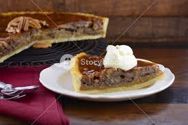 traditional thanksgiving individual serving of pecan pie on