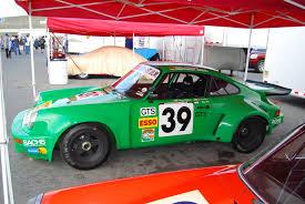 porsche rally car jump file flickr wbaiv green 39 porsche 911 gt3 race car jpg