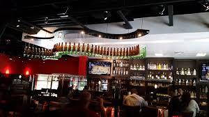 beer bottle light fixture their hanging beer bottle light fixture over the bar area yelp