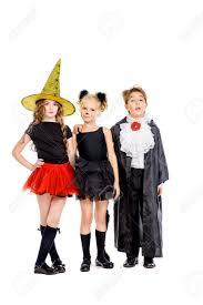cute kids halloween background group of cute children wearing halloween costumes posing over