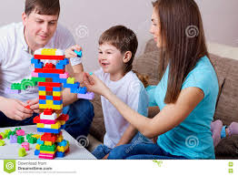 happy family with colorful blocks inside at home stock