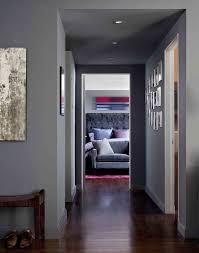 recessed baseboards grey baseboards hall contemporary with grey walls dark wood floor