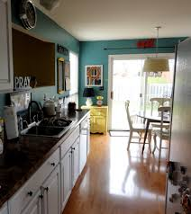 Galley Kitchen Lighting Ideas by Teal Wall Painted In Small Galley Kitchen Escorted By Wooden