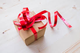 red ribbon on brown cardboard box free stock photo