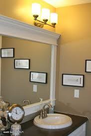 bathroom cabinets framing a mirror framed frame around bathroom