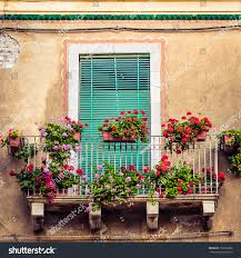 beautiful vintage balcony colorful flowers wooden stock photo