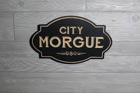 city morgue sign carved in wood retro style sign mortuary