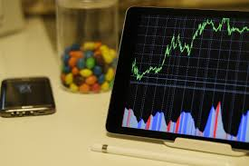 android tablet turned on displaying a graph free stock photo