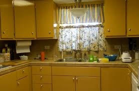 inside kitchen cabinet lighting yellow painted kitchen cabinets