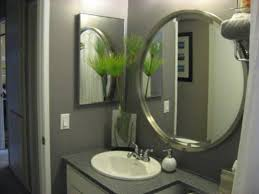 oval shape frameless bathroom wall mirror hang on grey wall color