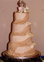 ivory rustic buttercream with fondant drapes and calla lilies