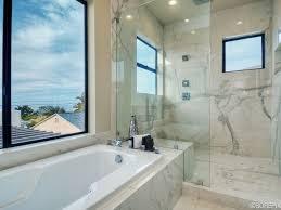 contemporary master bathroom with frameless showerdoor u0026 rain