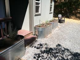 exterior design simple galvanized water trough with gravel for