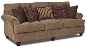 traditional stationary sofa with rolled arms and bun feet by