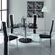 black glass kitchen table vo1 black glass round dining table with four chairs hgtv addict