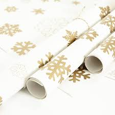 gold wrapping paper gold snowflakes white wrapping paper by