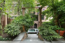 this 28m upper east side multi townhouse garden pool megamansion a completely otherworldly 2 000 square foot tiered garden connects the two houses with both northern and southern exposures