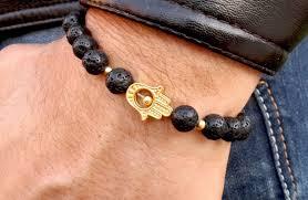 hand bracelet men images Golden hamsa hand bracelet mens hamsa bracelet black lava stone jpg