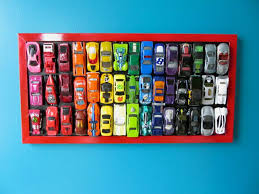 rainbow cars create a super cute wall hanging from your kid u0027s toy cars