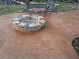 stained concrete patio with built in fire pit north by northwest