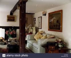 Cottage Sitting Rooms Upright Wooden Beam And Striped Sofa In Nineties Cottage Sitting