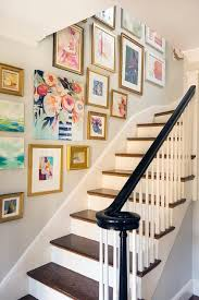 Staircase Wall Decor Ideas | decorating crush hanging art in the stairwell satori design for