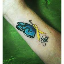 memorial kodi name and butterfly tattoo on wrist by garage ink