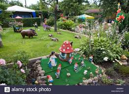 garden ornaments in an allotment berlin stock photo royalty free