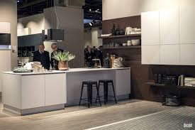 white island with solid surface countertop black backless bar