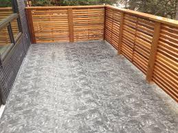 exterior concrete vinyl decking with wooden railing also grey