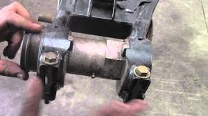 how to remove the rear axle bearing carrier on a polaris