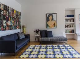 blue wall art black window trim pendant light white floor