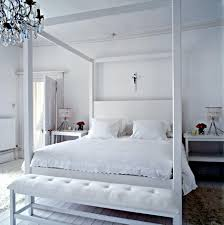 all white wooden bed frame with double sized bed in hollow canopy