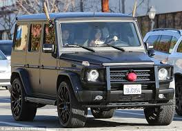 reindeer car jenner shows reindeer decked car as she steps out in